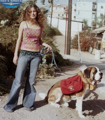 Baloo in pack gear with brandy barrel and model Yarden  Lev